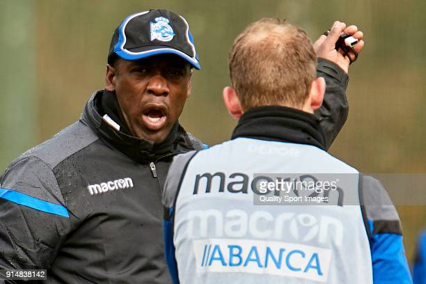 Clarence Seedorf the new manager of Deportivo de La Coruna gives instructions to Michael Krohn Dheli of Deportivo de La Coruna during his first...