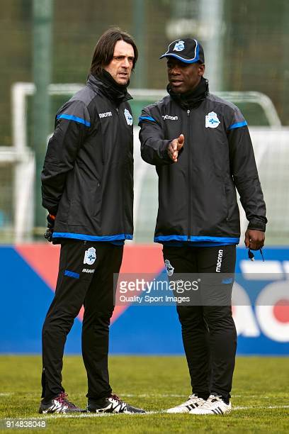 Clarence Seedorf the new manager of Deportivo de La Coruna talks with Valerio Fiori the second manager during his first training session at Abegondo...