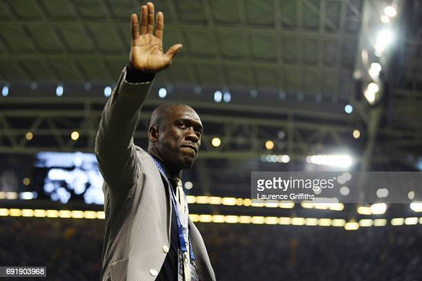 Clarence Seedorf waves to fans inside the stadium prior to the UEFA Champions League Final between Juventus and Real Madrid at National Stadium of...