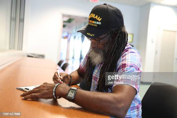 Clarence Singleton registers to vote at the Lee County Supervisor of Elections office on January 08 2019 in Fort Myers Florida Mr Singleton is able...