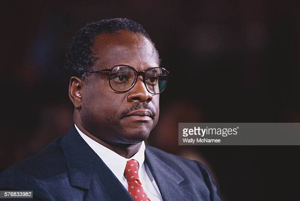 Clarence Thomas awaits proceedings during his hearing regarding the alleged sexual harassment of Anita Hill.