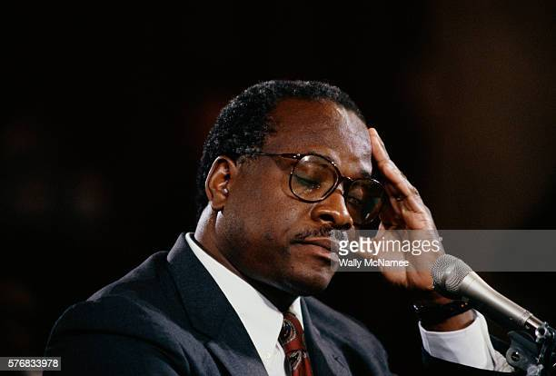 Clarence Thomas closes his eyes and puts his hand to his head during his hearing regarding the alleged sexual harassment of Anita Hill.