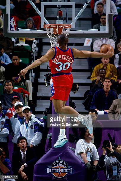 Clarence Weatherspoon of the Philadelphia 76ers attempts a dunk during the 1993 NBA Slam Dunk Contest on February 20 at the Delta Center in Salt Lake...