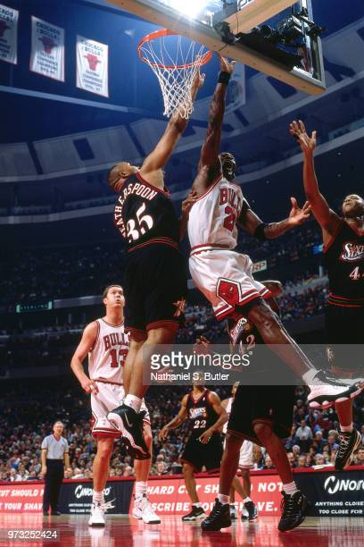 Clarence Weatherspoon of the Philadelphia 76ers defends Michael Jordan of the Chicago Bulls during a game played on November 1 1997 at the First...