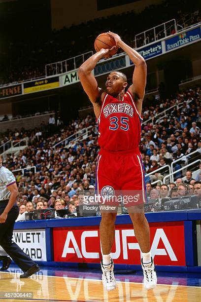 Clarence Weatherspoon of the Philadelphia 76ers shoots against the Golden State Warriors on January 3 1997 at the Arena in Oakland in Oakland...