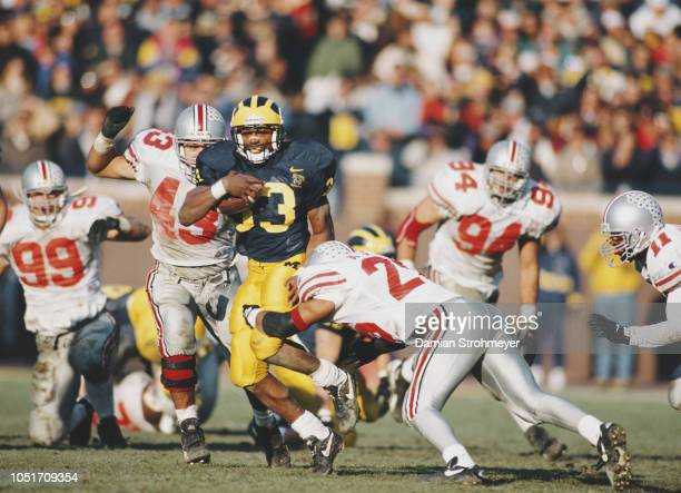 Clarence Williams Running Back for the University of Michigan Wolverines runs the ball against the Ohio State Buckeyes defense during their NCAA...