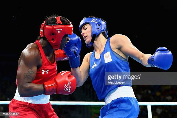 Claressa Maria Shields of the United States and Nouchka Fontijn of the Netherlands compete during the Women's Middle Final Bout on Day 16 of the Rio...