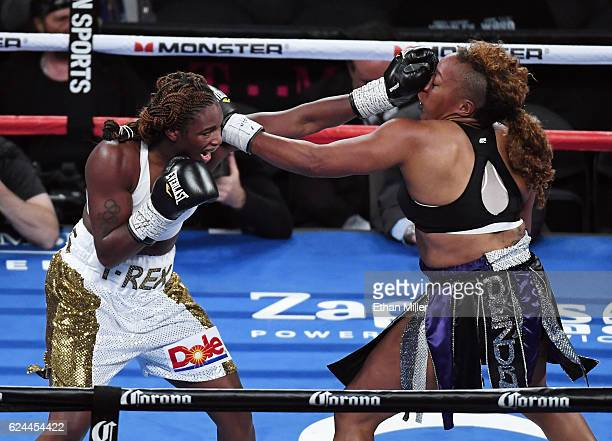 Claressa Shields hits Franchon Crews with a left in the fourth round of their super middleweight bout at TMobile Arena on November 19 2016 in Las...