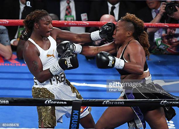 Claressa Shields hits Franchon Crews with a left in the second round of their super middleweight bout at TMobile Arena on November 19 2016 in Las...