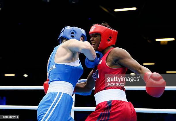 Claressa Shields of the USA defends against Nadezda Torlopova of Russia during the women's boxing Middleweight final of the 2012 London Olympic Games...