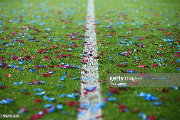Claret and blue confetti is seen on the pitch after the Barclays Premier League match between West Ham United and Manchester United at the Boleyn...