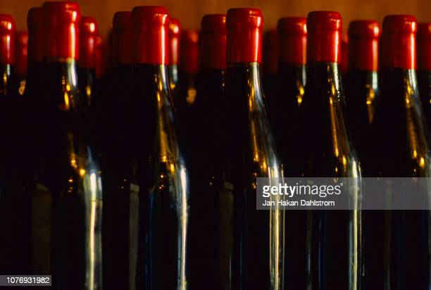 claret wine bottles - french culture stock pictures, royalty-free photos & images