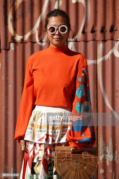 Clarice Chian wearing Poustovit dress Binny skirt Celine Shoes Cult Gaia bag Gucci sunglasses during MercedesBenz Fashion Week Resort 18 Collections...
