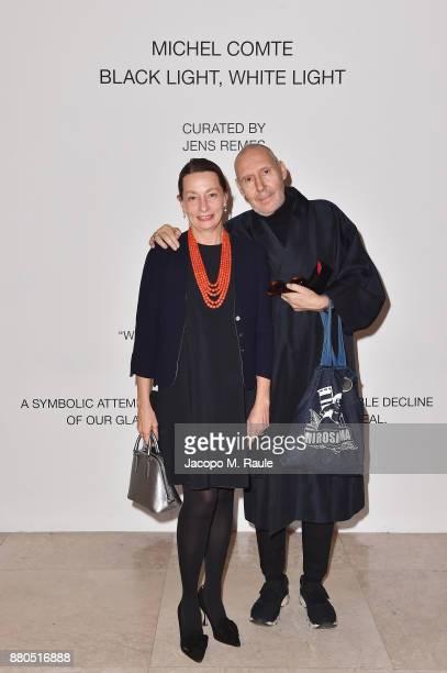 Clarice Pecori Giraldi and Michel Comte attend Michel Comte Black Light White Light Opening at Triennale di Milano on November 27 2017 in Milan Italy