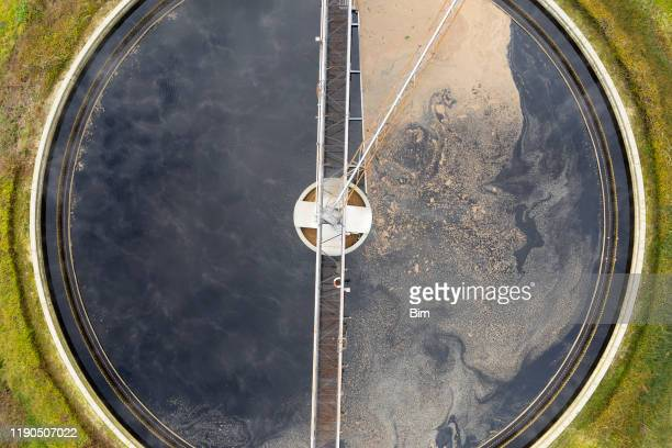 clarifier at wastewater treatment plant, aerial view - sewer stock pictures, royalty-free photos & images