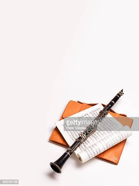 Clarinet and music on white background