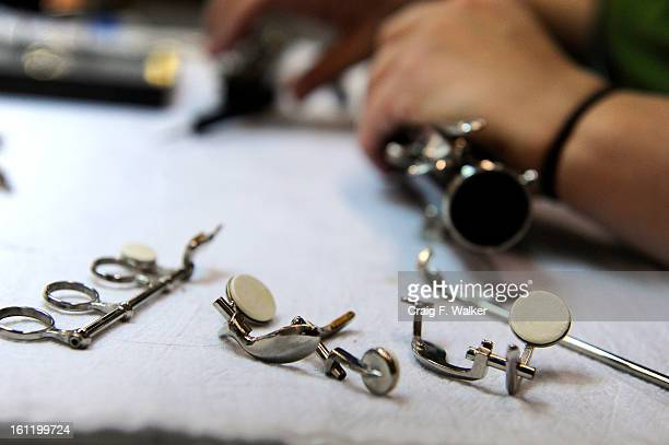 Clarinet and Oboe technician Jacalyn Schlies sets new pads on a clarinet at Colorado Institute of Musical Instrument Technology in Castle Rock CO...