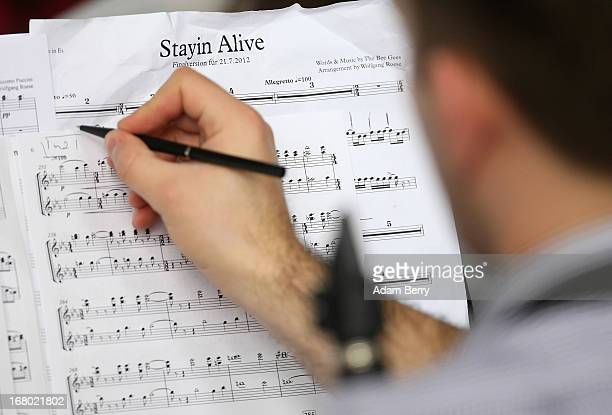 A clarinet player in the ORSO Rock Symphony Orchestra writes down notes on sheet music for an orchestral version of the Bee Gees' 'Stayin' Alive'...