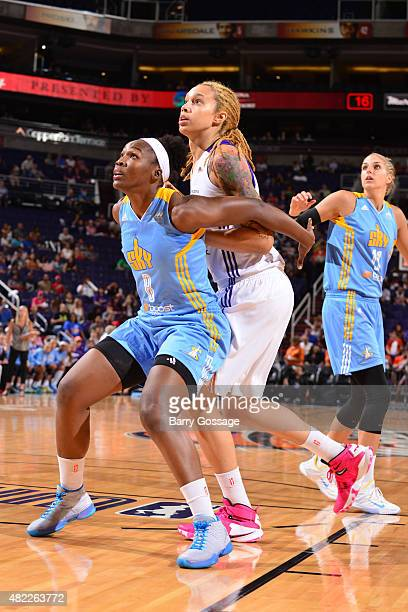 Clarissa Dos Santos of the Chicago Sky battles Brittney Griner of the Phoenix Mercury for position on July 27 2015 at Talking Stick Resort Arena in...