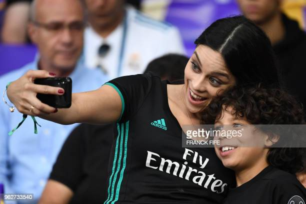 Clarisse Alves and Enzo the wife and son of Real Madrid's Brazilian defender Marcelo pose for a selfie during the UEFA Champions League final...