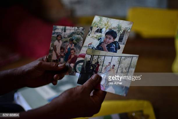 Clarita Alia showing the photos of her four sons that was allegedly killed by the infamous Davao Death Squad on May 8 2016 in Davao City Mindanao...