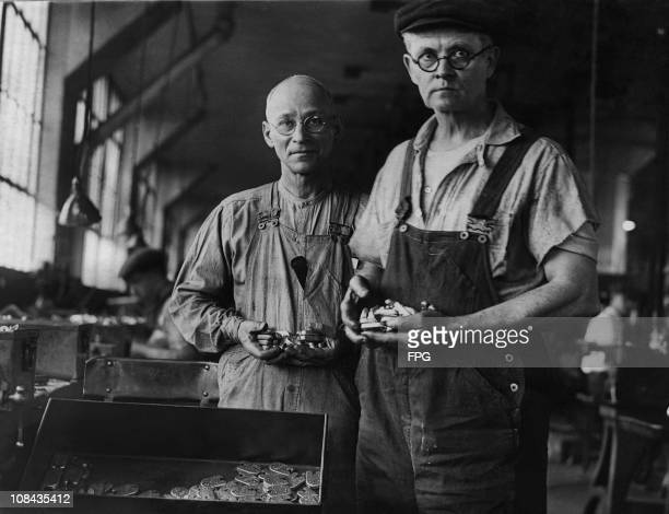 AB Clark a foreman in the government service repairing and inspecting locks and TA Richardson key and lock specialist at work in 1935
