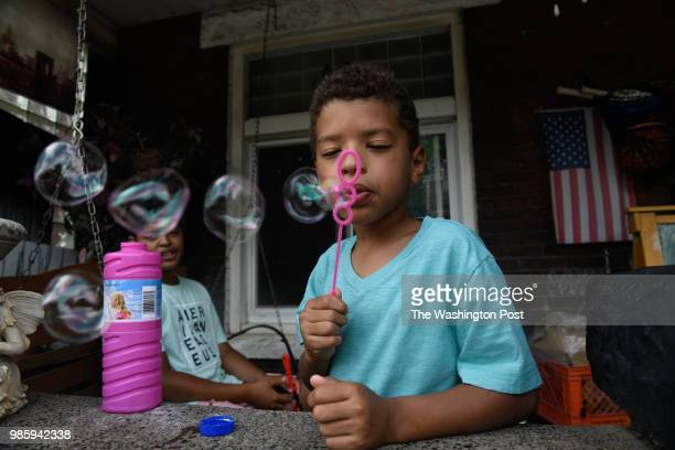 Clark Cannon blows bubbles on the front porch of his home on June 24 2018 in East Pittsburgh Pa The Cannons live very close to the location where...