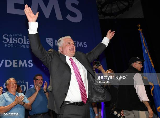 Clark County Commission Chairman and Democratic gubernatorial candidate Steve Sisolak reacts after winning his race against Nevada Attorney General...