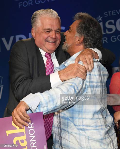 Clark County Commission Chairman and Democratic gubernatorial candidate Steve Sisolak hugs a supporter after Sisolak won his race against Nevada...