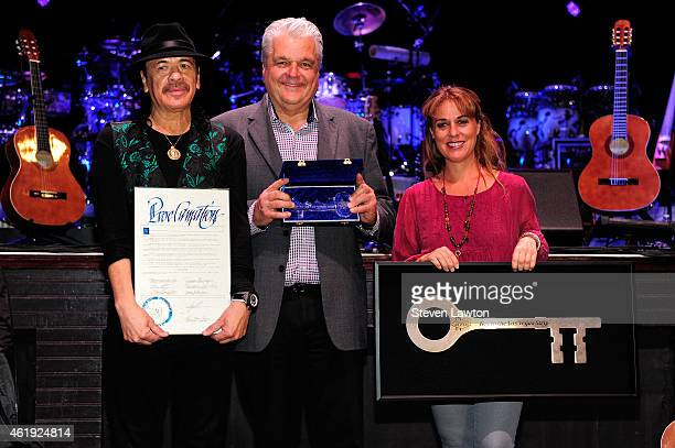 Clark County Commissioner Steve Sisolak presents recording artist Carlos Santana with a ceremonial key to the Las Vegas Strip as Director of Hermes...