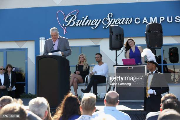 Clark County Commissioner Steve Sisolak speaks as singer Britney Spears and talent manager Larry Rudolph look on during the grand opening of the...
