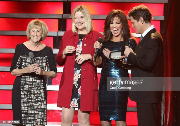 Clark County Commissioner Susan Brager and Regional President of the Flamingo Las Vegas Eileen Moore look on as entertainers Marie Osmond and her...