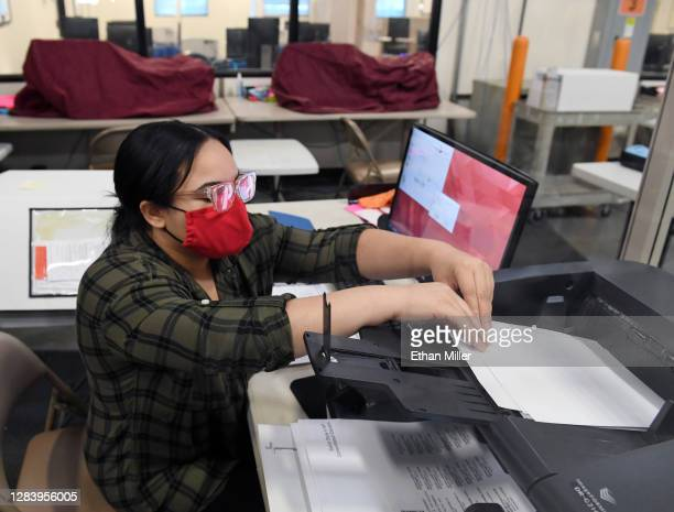 Clark County election worker scans mail-in ballots at the Clark County Election Department on November 4, 2020 in North Las Vegas, Nevada. U.S....