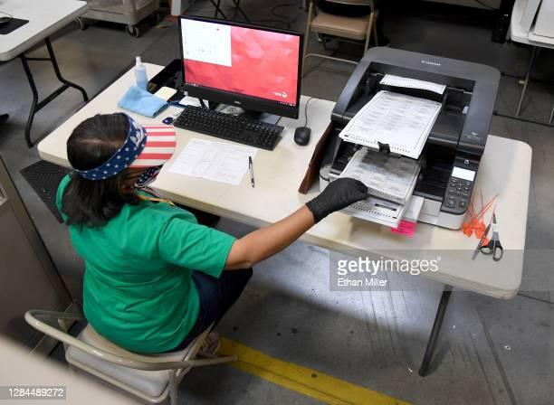 Clark County election worker scans mail-in ballots at the Clark County Election Department on November 7, 2020 in North Las Vegas, Nevada. Joe Biden...