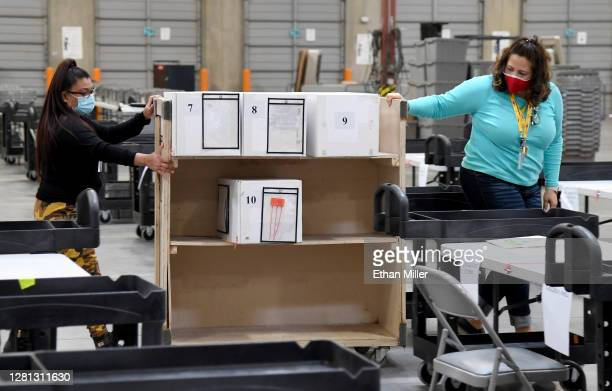 Clark County election workers move boxes of mail-in ballots to be scanned at the Clark County Election Department on October 20, 2020 in North Las...