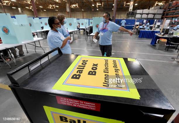 Clark County election workers talk behind a ballot box at the Clark County Election Department which is serving as both a primary election ballot...
