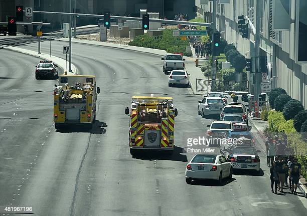 Clark County Fire trucks are parked outside an entrance to The Cosmopolitan of Las Vegas after a fire broke out on a rooftop pool deck on July 25...