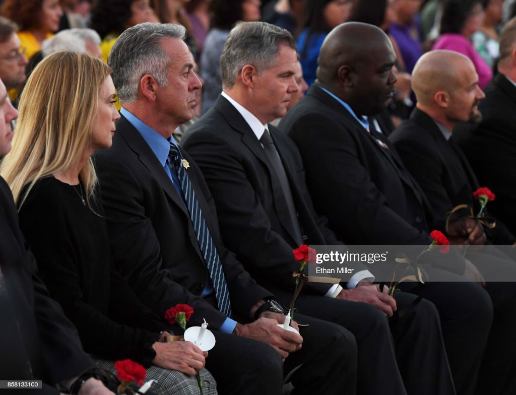 Clark County Sheriff Joe Lombardo (2nd L) and MGM Resorts International Chairman and CEO Jim Murren (C) attend a vigil for Las Vegas Metropolitan Police Department Officer Charleston Hartfield at Police Memorial Park on October 5, 2017 in Las Vegas, Nevada. Hartfield, who was off duty at the Route 91 Harvest country music festival on October 1, was killed when Stephen Paddock opened fire on the crowd killing at least 58 people and injuring more than 450. The massacre is one of the deadliest mass shooting events in U.S. history.
