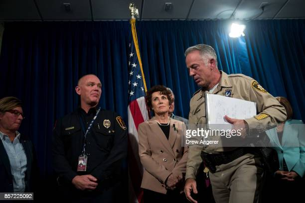 Clark County Sheriff Joe Lombardo exits after briefing reporters on the ongoing investigation into Sunday night's mass shooting at Las Vegas...