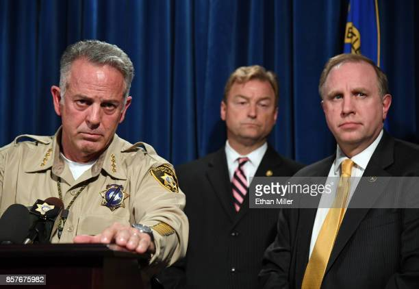 Clark County Sheriff Joe Lombardo US Sen Dean Heller and FBI Las Vegas Division Special Agent in Charge Aaron Rouse listen to a question during a...