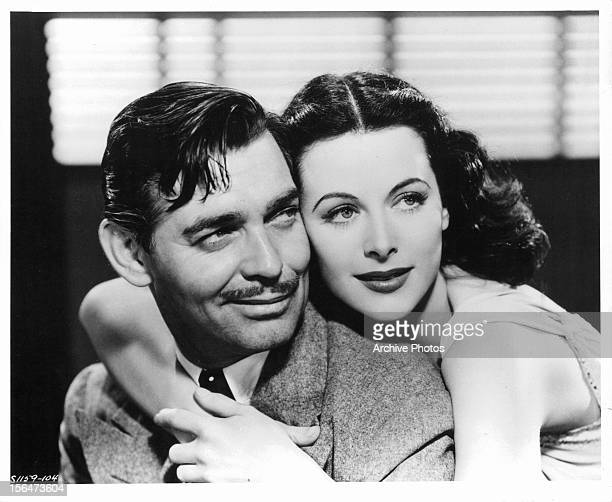 Clark Gable and Hedy Lamarr embracing in publicity portrait for the film 'Comrade X', 1940.