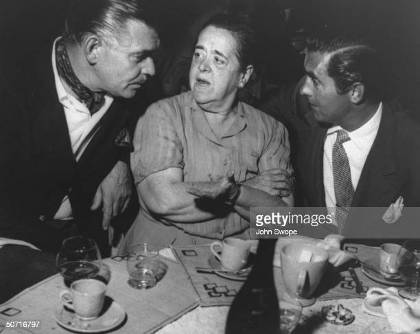 Clark Gable and Tyrone Power with Elsa Maxwell during party on the Riviera