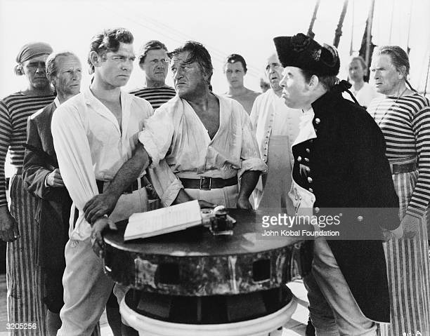 Clark Gable as Fletcher Christian and Charles Laughton as the brutal Captain Bligh in 'Mutiny on the Bounty' directed by Frank Lloyd