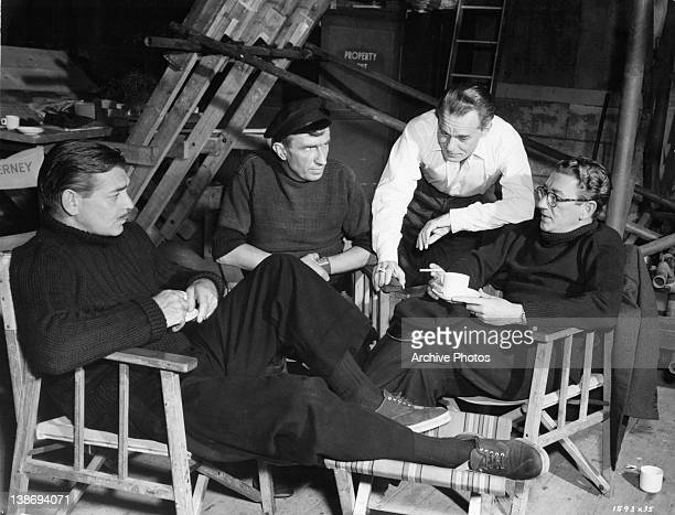 Clark Gable Bernard Miles Karel Stepanek and Richard Haydn relaxing between shots from the film 'Never Let Me Go' 1953