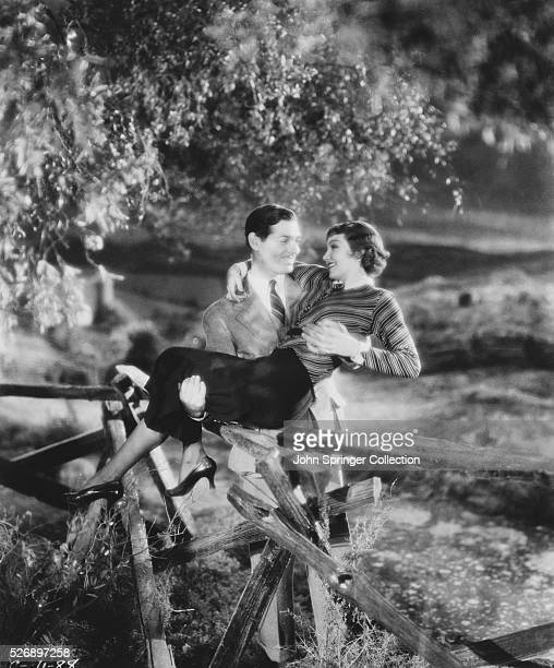 Clark Gable Carrying Claudette Colbert