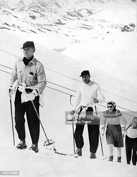 Clark Gable Gary Cooper and his wife skiing in Sun Valley Idaho United States