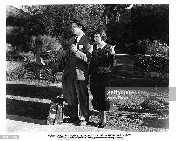 Clark Gable hitchhikes with Claudette Colbert in a scene from the film 'It Happened One Night' 1934