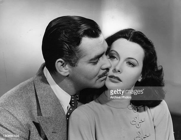 Clark Gable kisses Hedy Lamarr in a scene from the film 'Comrade X', 1940.