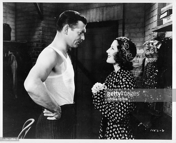 Clark Gable looking at Norma Shearer with hands at his waist in a scene from the film 'Idiot's Delight' 1939