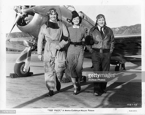 Clark Gable Myrna Loy and Spencer Tracy arm in arm in a scene from the film 'Test Pilot' 1938